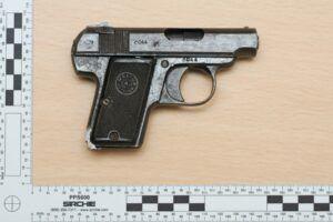 small automatic pistol
